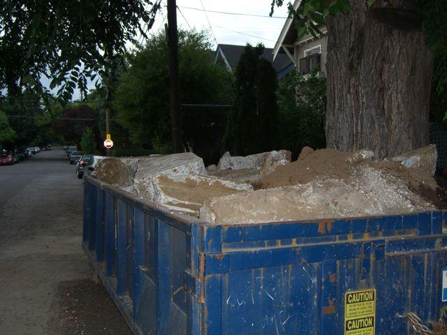 Dumpster full of concrete
